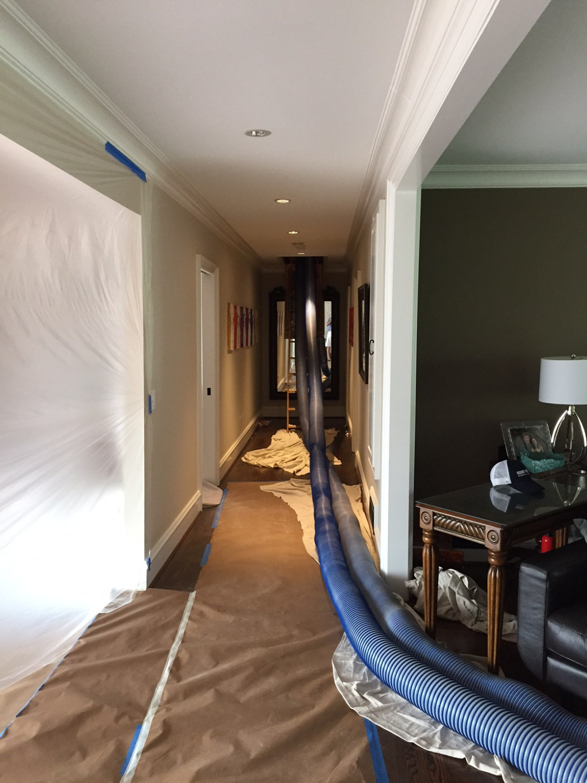 North Atlanta home having insulation added to attic to improve comfort and efficiency.