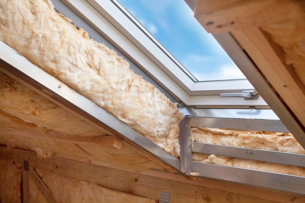 skylight window in ceiling, attic with insulation exposed